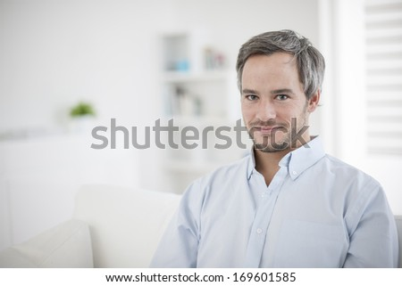 Portrait of handsome man relaxing at home