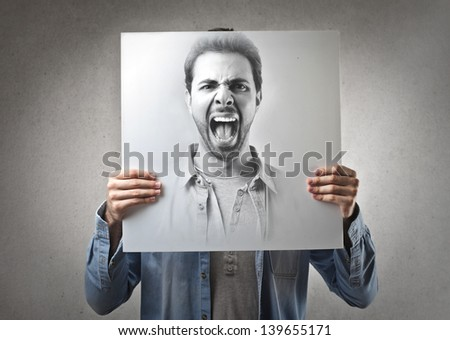 portrait of handsome man screaming