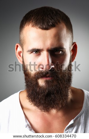 Portrait of handsome man standing, isolated on grey background Stock photo ©