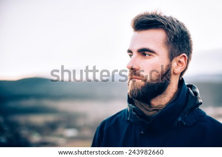 Portrait of handsome man with a beard #243982660