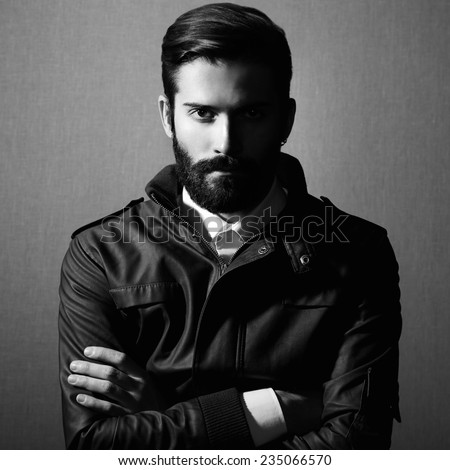 Portrait of handsome man with beard Fashion photo Black and white photo