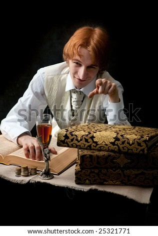 Portrait of handsome man with the glass of wine and old books.