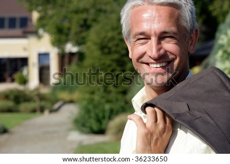 Portrait of handsome mature businessman smiling