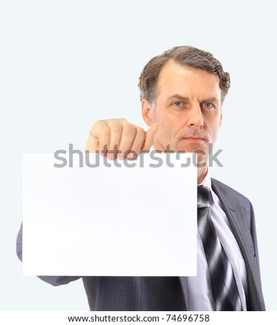 Portrait of handsome mature bussiness male executive pointing at empty white board