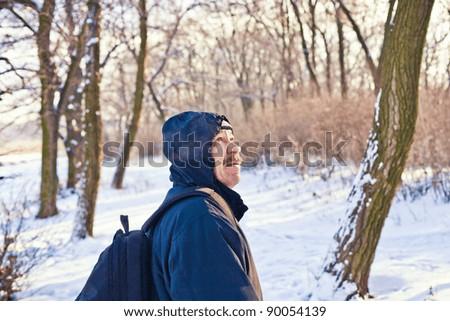 portrait of handsome men in the snowy field