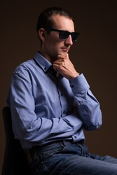portrait of handsome middle aged man in sunglasses