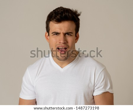 Portrait of handsome shocked young man hearing unexpected news. latin male looking at something shocking with worried and surprised face making concern gestures. Expression and Emotions.
