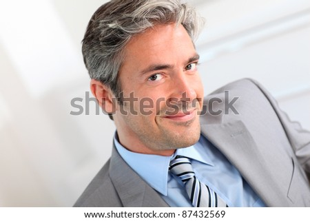 Portrait of handsome smiling businessman