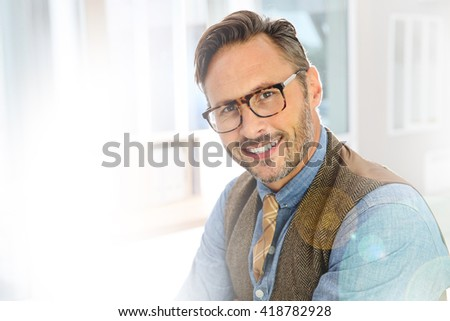 Portrait of handsome stylish guy with eyeglasses - Shutterstock ID 418782928