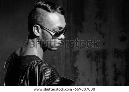 Portrait of handsome stylish man in elegant black jacket #669887038