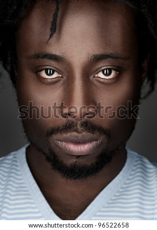 Portrait of handsome young african american man looking at camera