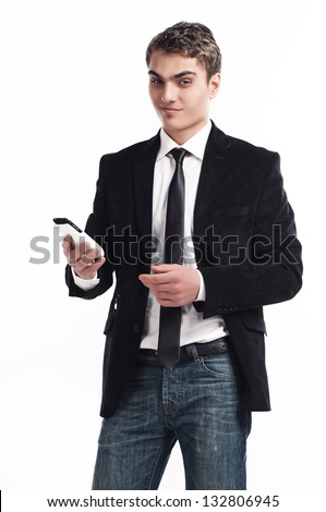 Portrait of handsome young business man using cell phone, smiling