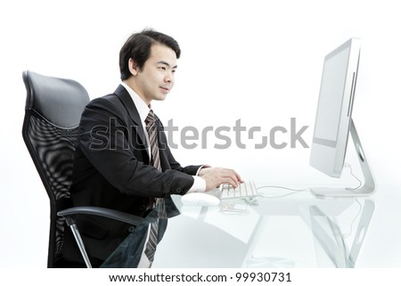 Portrait of handsome young business man using computer - stock photo