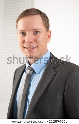 portrait of handsome young businessman smiling