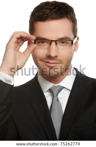Portrait of handsome young businessman wearing glasses  isolated on white background