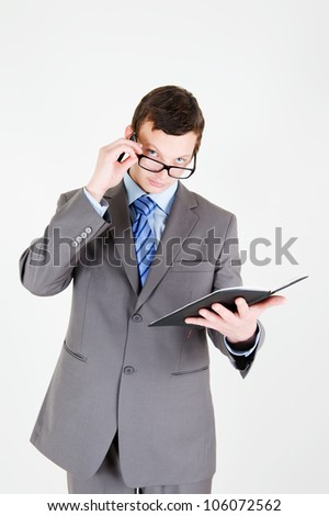 Portrait of handsome young businessman with notebook