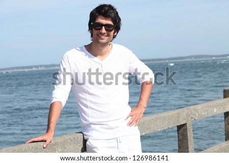 portrait of handsome young man at sea resort