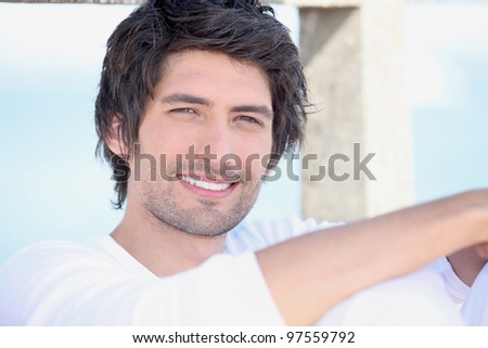 portrait of handsome young man by sea