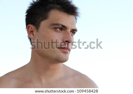 Portrait of Handsome young man looking away - stock photo