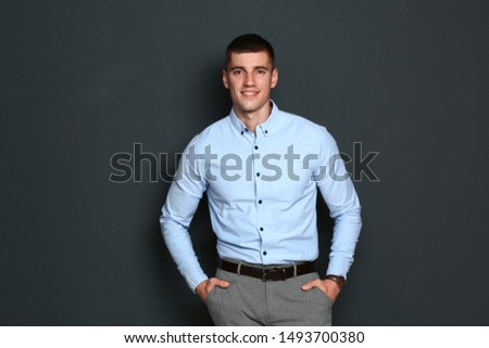 Portrait of handsome young man on dark background