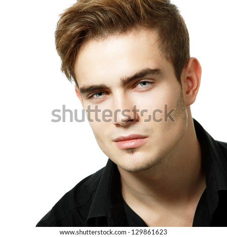 Portrait of handsome young man, sexy guy looking at camera over white background