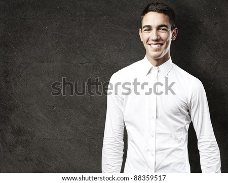 portrait of handsome young man smiling against a grunge background
