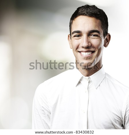portrait of handsome young man smiling in a house
