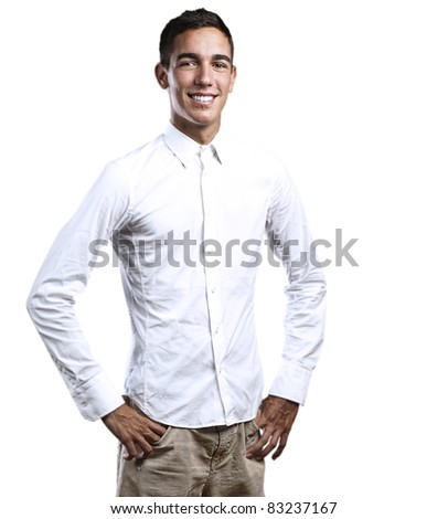 portrait of handsome young man smiling on a white background
