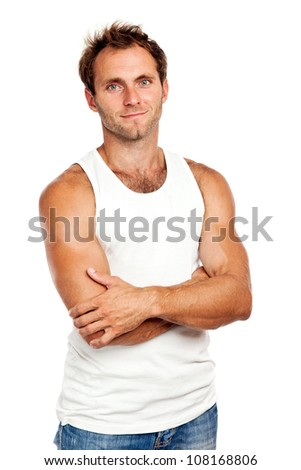 Portrait of handsome young man standing with arms crossed on white background