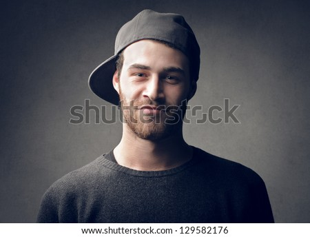 portrait of handsome young man with cap