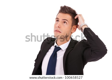 Portrait of handsome young thoughtful businessman isolated over white background
