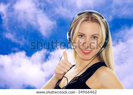 Portrait of happiness sexy young women with beautiful face in headphones and listening music on the sky background