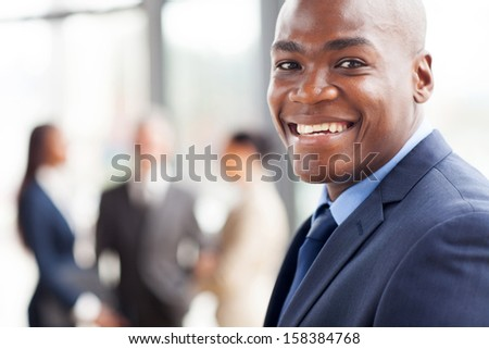 portrait of happy african businessman in office
