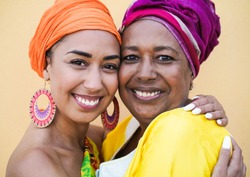 Portrait of happy african mother and daughter face to face while hug each other - Family, mother and adult child love - Women with traditional dress