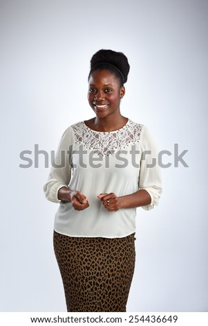 Portrait of happy african woman standing against white background