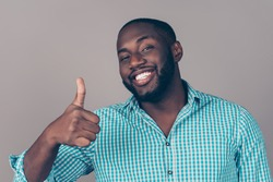 Portrait of happy afroamerican handsome bearded  man laughing and showing thumb up gesture