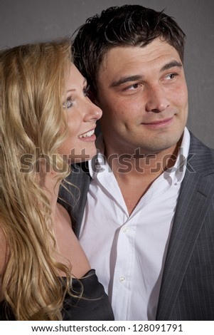 Portrait of happy and smiling couple in studio