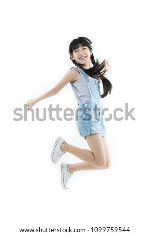 Portrait of Happy Asian child girl jumping and smiling isolated on white background