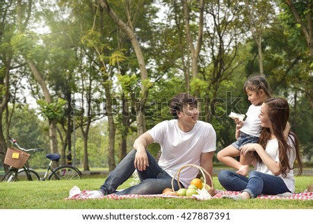 Portrait Of Happy Asian Family In Garden
