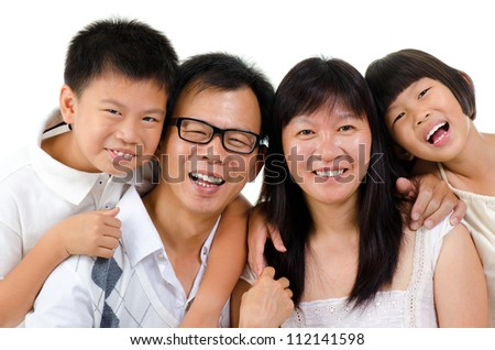 Portrait of happy Asian family isolated on white background