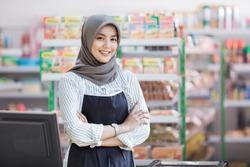 portrait of happy asian female shopkeeper