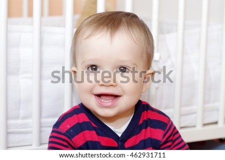 portrait of happy baby age of 1 year against white bed #462931711