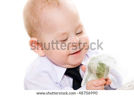 Portrait of happy baby boy with dollar banknote isolated on white background