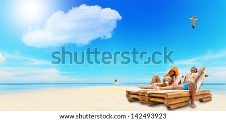 Portrait Of Happy Beautiful Couple Enjoying their summer holidays on a tropical beach