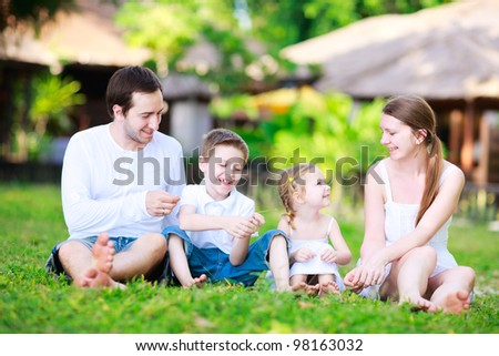 Portrait of happy beautiful family outdoors on summer day