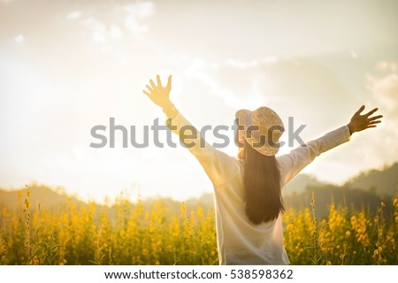 Shutterstock portrait of happy beautiful happy youngwoman relaxing in park. Joyful female model breathing fresh air outdoors and enjoying smell in a flower spring or summer garden, vintage tone.
