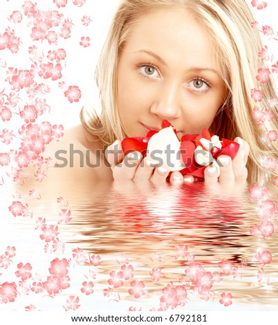 portrait of happy blond in spa with red and white rose petals