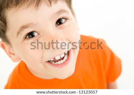 Portrait of happy boy laughing on a white background - stock photo
