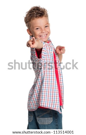 Portrait of happy boy pointing at you isolated on white background