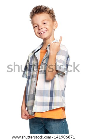 Portrait of happy boy showing rock and roll sign isolated on white background Foto stock ©